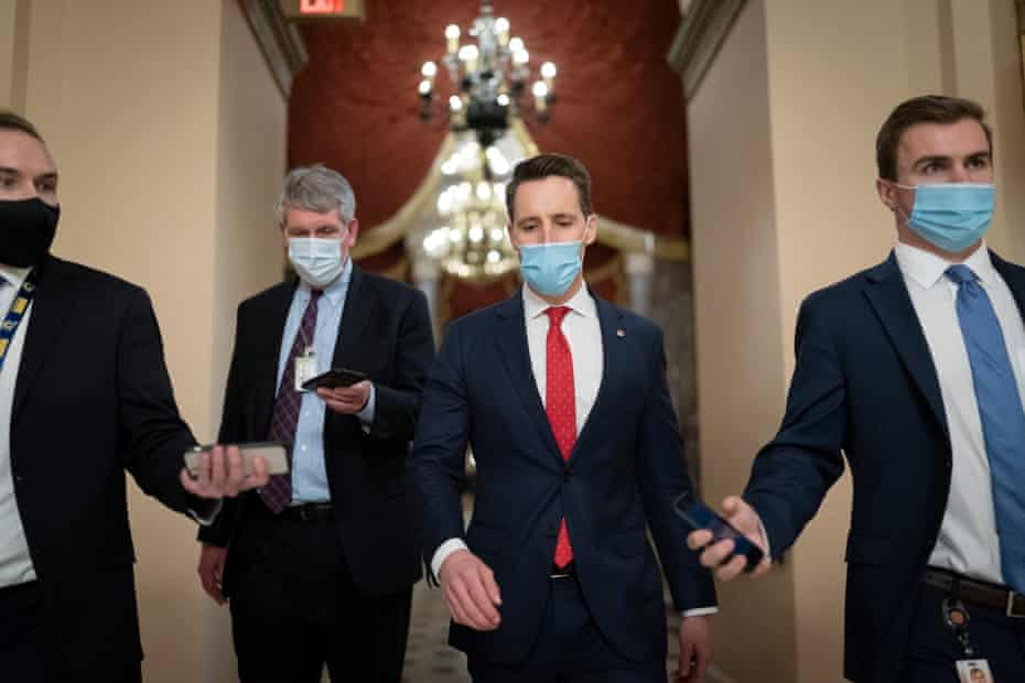Josh Hawley walks to the House chamber to challenge the presidential election results on 6 January.
