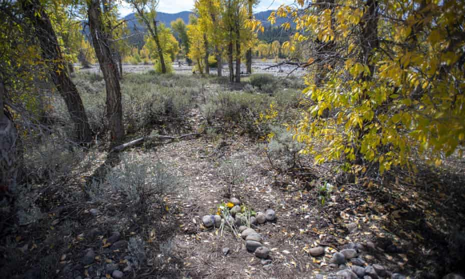 A stone cross marks a spot in northwest Wyoming's Bridger-Teton National Forest, where Gabby Petito's body was found.