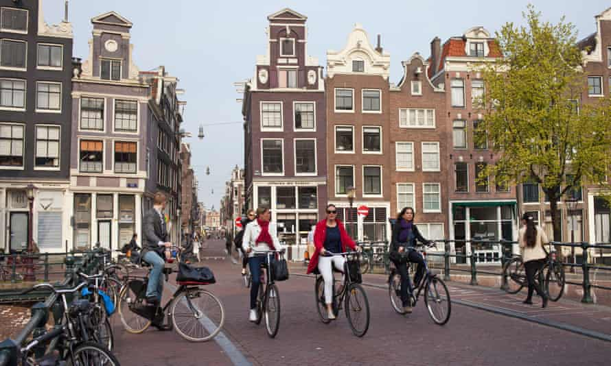 People ride bicycles in Amsterdam