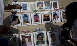 Women adorn photographs of missing people to call attention to the cases on Mothers Day in Mexico City, on 10 May.