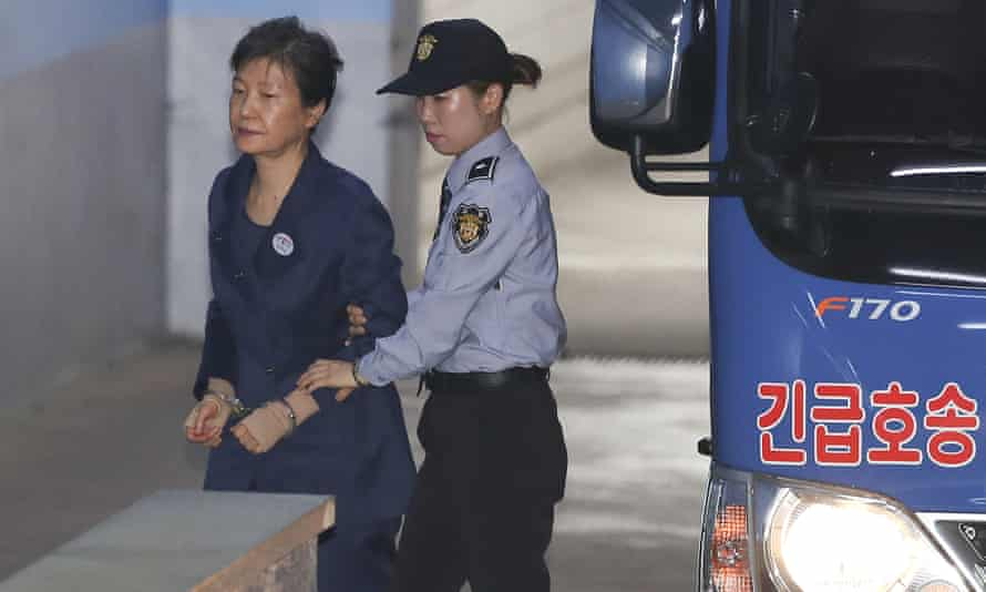 Park Geun-hye arrives in handcuffs for her trial in Seoul on Monday.