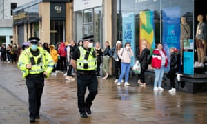 Police patrol alongside the queue outside the Primark store on Princes Street in Edinburgh