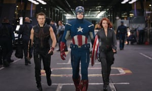 As Hawkeye, with Captain America (Chris Evans) and Black Widow (Scarlett Johansson) in The Avengers Assemble .