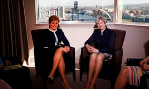 Nicola Sturgeon (left) and Theresa May pose of a photograph during a meeting in a Glasgow hotel.