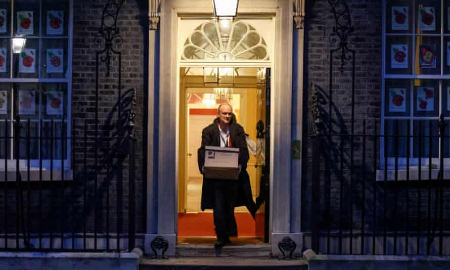 Dominic Cummings is seen carrying out boxes from No 10 Downing Street on Friday.