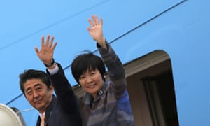 Japanese Prime Minister Shinzo Abe and his wife Akie Abe wave while boarding Air Force One