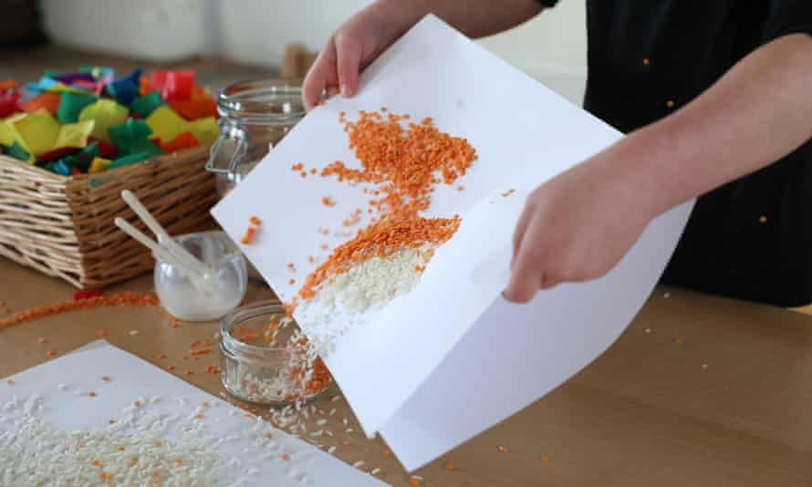 Children in Tops Day Nursery in Christchurch, Dorset, use lentils and rice to make pictures after the nursery banned the use of glitter due to concerns about the damage it does to the environment.