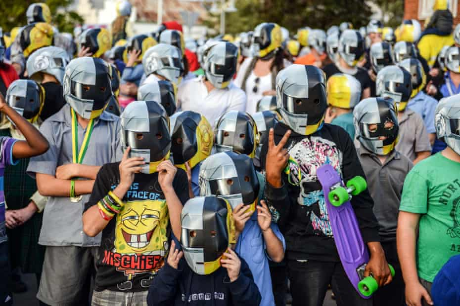 A group of Daft Punk fans and locals in masks at the Wee Waa show