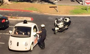 A Google self-driving car is pulled over by a police officer in California this week.