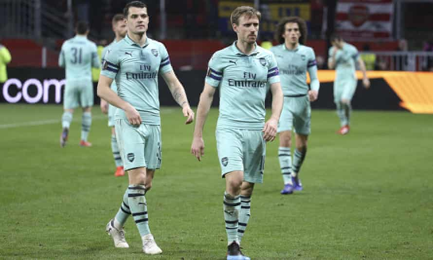 The Arsenal players trudge off after their Europa League capitulation against Rennes