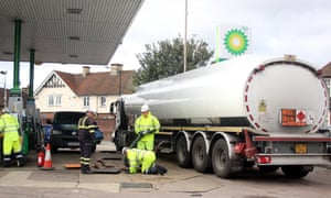 Military personnel are being trained to refuel the BP garage at Farm Hill Road, Waltham Abbey, Essex this afternoon.