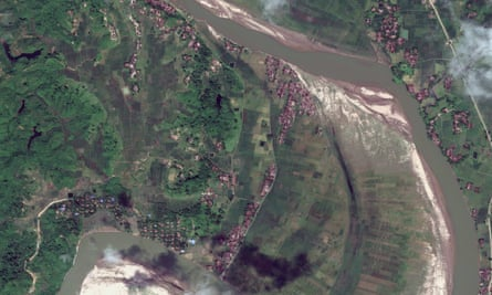 A satellite image of the village of Tula Toli showing many of the homes burnt an destroyed.