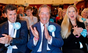 The Brexit party leader, Nigel Farage, reacts after the European parliament election results.