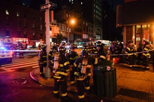 New York City firefighters stand near the site of the blast.