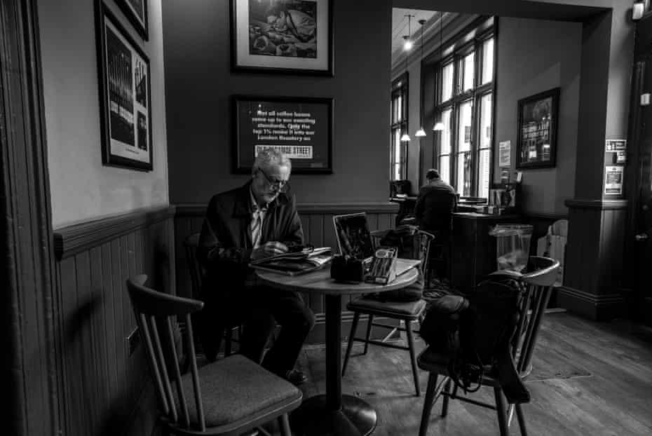 Corbyn works while waiting for the train on the way back from Morecambe, in March.