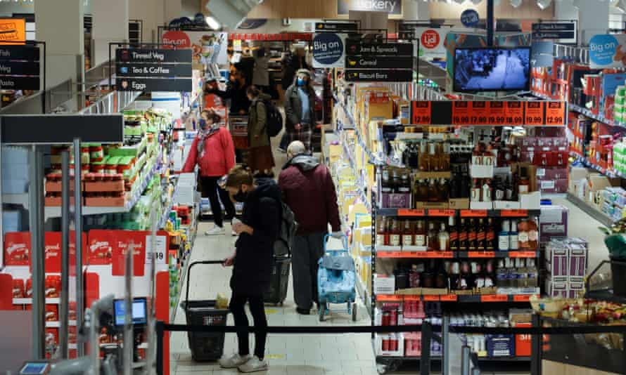 Shoppers browse for goods inside a Lidl supermarket in Walthamstow, London