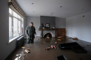Gabrielle Burns-Smith stands in her flooded home on the outskirts of Lymm in Cheshire as Storm Christoph caused widespread flooding across the country.