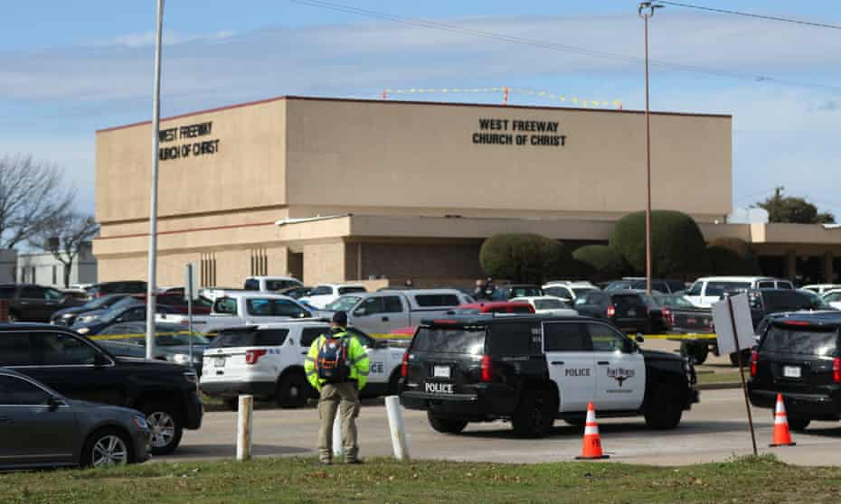 A person stands near the scene of a church shooting at West Freeway Church of Christ on Sunday in White Settlement, Texas.