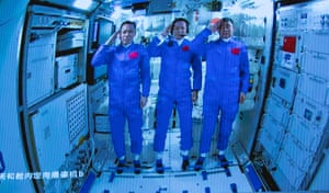 The three Chinese astronauts onboard the Shenzhou-12 spaceship saluting after entering the Tianhe space station core module in Beijing