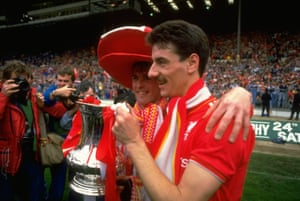 Liverpool's Kenny Dalglish (left) and Ian Rush of Liverpool pose with the trophy after beating Everton 3-1 in the 1986 FA Cup final .