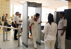Tourists pass through security