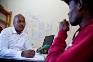 Tsotleho Maramane, a nurse at Khotla, with a patient