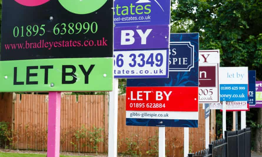To let estate agent signs in a row advertising property in UK