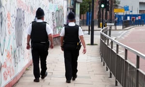 Two police officers on the beat in London