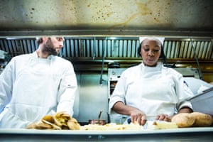Montima (right), a student, prepares a meal in kitchen at Edwins.