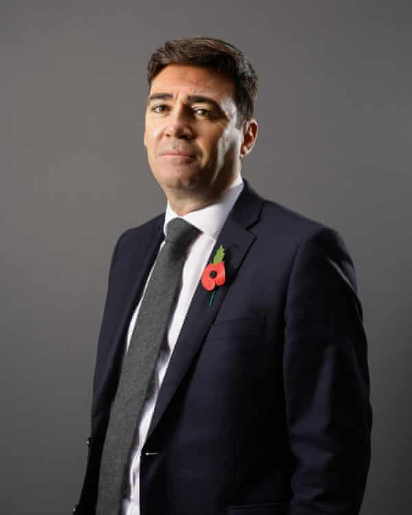 Formal portrait of Andy Burnham in a suit and tie