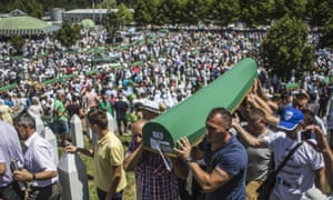 Coffins of newly identified victims of the 1995 Srebrenica massacre are laid to rest in 2015.