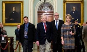 Senate majority leader Mitch McConnell walks near the Senate chamber before the Senate impeachment trial in the US Capitol