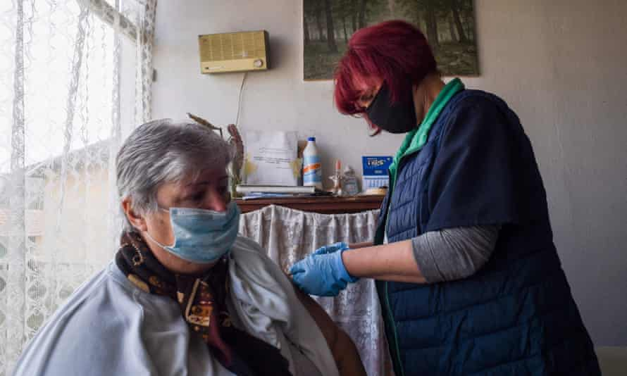 Stefka Hristova, mayor of the village of Gardevtsi, in Bulgaria receives a dose of the Oxford/AstraZeneca vaccine.