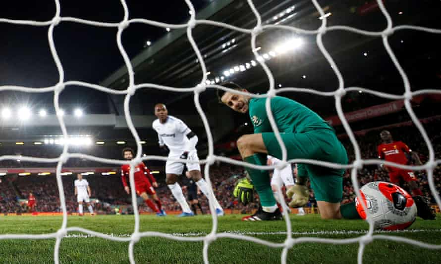 Lukasz Fabianski lets Mohamed Salah's shot slip through his hands for Liverpool's equaliser.