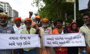 Indian members from the Vaadi community participate in a protest in support of Shantadevi Nath, who was killed by a mob who wrongly believed she was intent on abducting children.