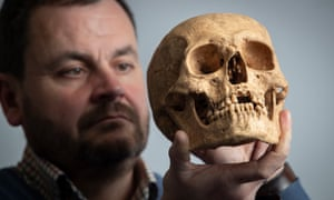 Hugh Willmott, of Sheffield University, with a skull discovered at the site.
