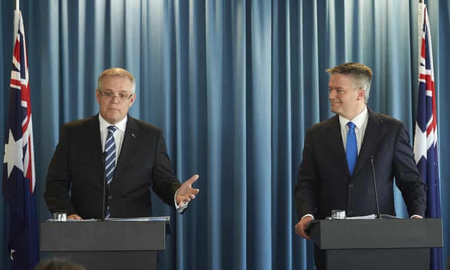 The treasurer, Scott Morrison, left, and the finance minister, Mathias Cormann, explain the Coalition's midyear economic and fiscal outlook (Myefo) for 2015-16 on Tuesday.