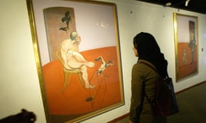 """An Iranian woman looks at the lefthand panel of Francis Bacon's triptych, Two Figures Lying on a Bed with Attendant"""" (1968)."""