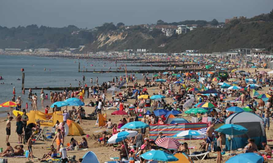 People enjoy the sunshine on Bournemouth beach during the late August bank holiday 2019.