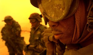 A US soldier in Kuwait, where a weather record has been set.
