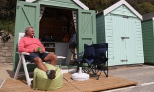 Rob Underhill outside his beach hut on Bournemouth beach in Dorset on the first day of easing for some coronavirus lockdown restrictions in England.