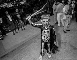 Boy in Skeleton Costume Waving Stick, Etla, 2001