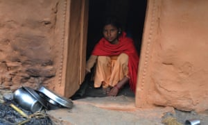 A 13-year-old Nepalese villager inside a chhaupadi house in the village of Achham, western Nepal.