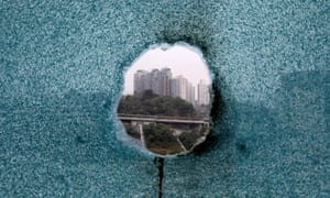 A shattered window is seen during a search operation at Hong Kong Polytechnic University