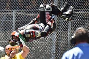 Moto2 rider Johann Zarco jumps to celebrate after winning the Moto2 race as part of the Italian Moto Grand Prix in Mugello.
