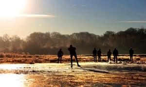 Tietjerk,Netherlands The first skaters on natural ice in the Ryptsjerksterpolder