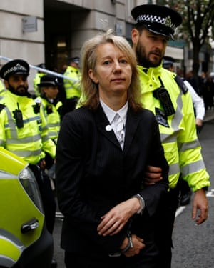 Extinction Rebellion co-founder Gail Bradbrook being arrested after a protest in London in October 2019.