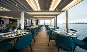 Water works: RAS restaurant has dramatic views across the river.