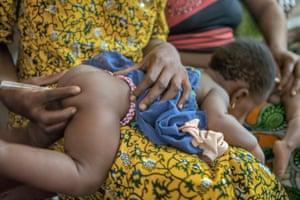 Baby having temperature taken in Benin
