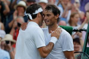Federer and Nadal embrace at the net.